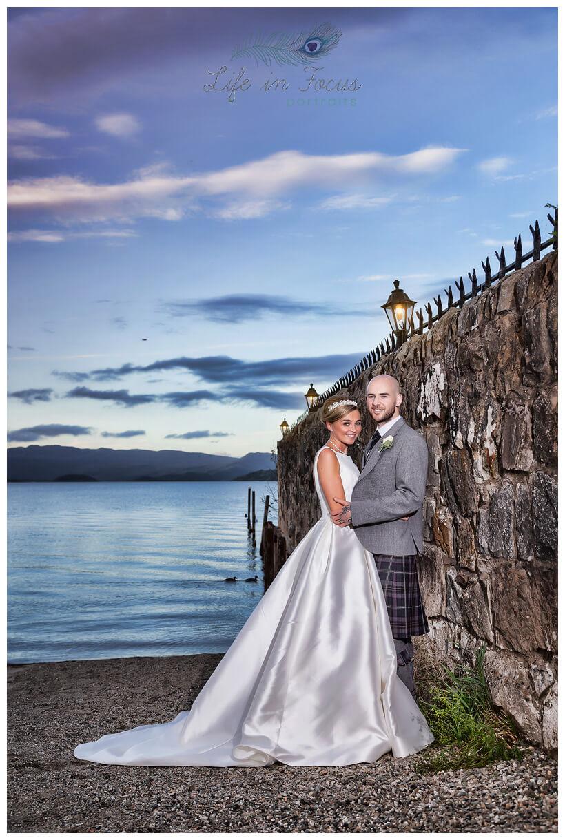 Bride and Groom lochside wedding photo Duck Bay MArina Hotel Loch Lomond Life in Focus Portraits wedding photographer Helensburgh Argyll and Bute