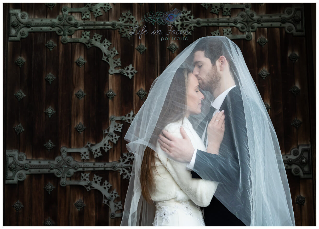 Bride and groom under veil Scottish castle wedding Life in Focus Portraits wedding photos Argyll and Bute