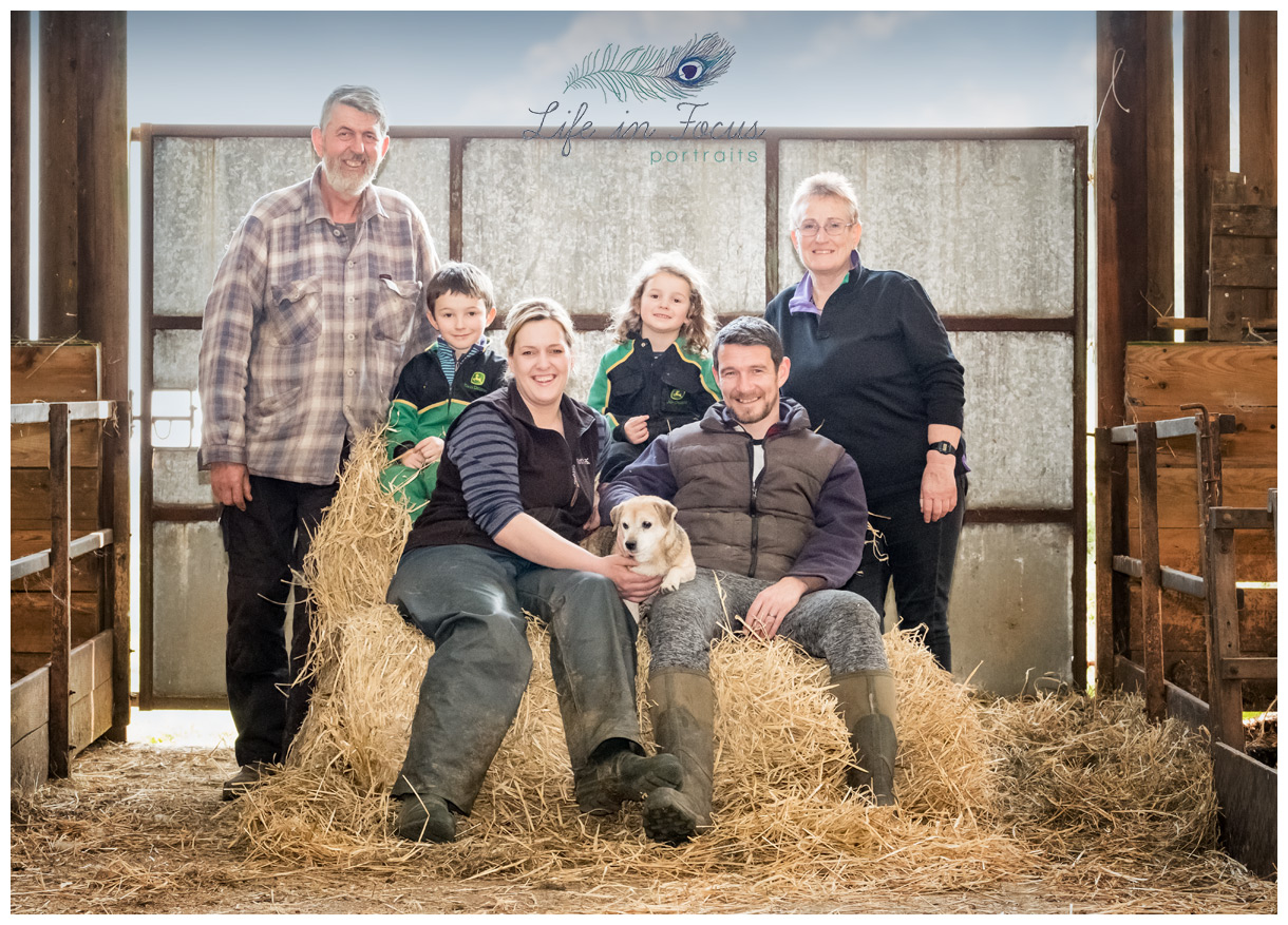 Family portrait in barn Lennox Family Lambing on Loch Lomond This Farming Life Life in Focus Portraits outdoor family photographer Luss Loch Lomond