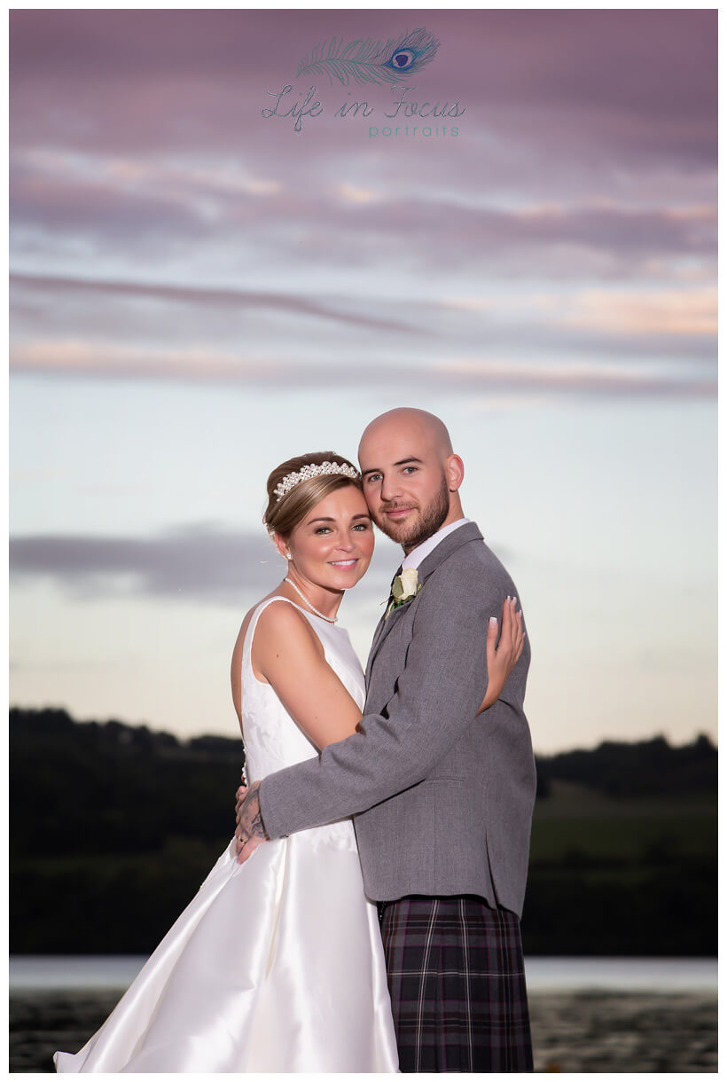 Lochside wedding photo newly married couple at sunset Life in Focus Portraits wedding photographer Rhu Helensburgh Gare Loch