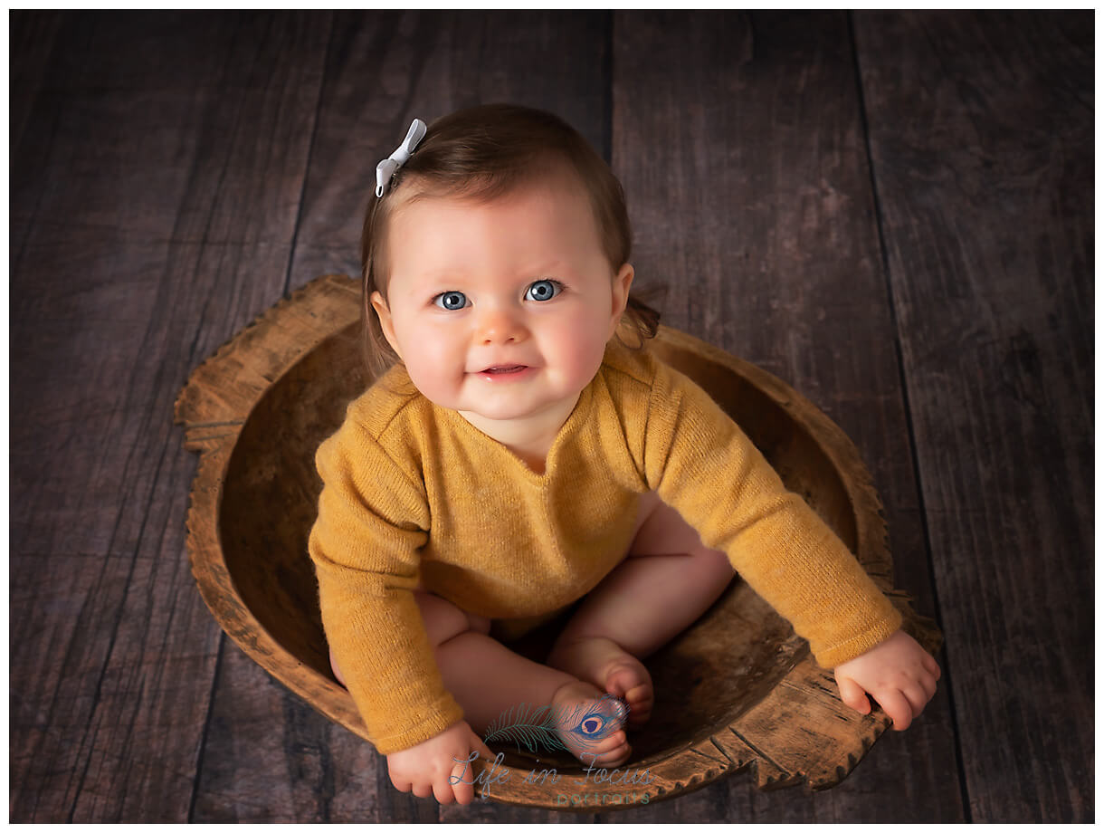 baby girl 8 month old sitting up baby milestones Life in Focus Portraits baby and child photo sessions Rhu Helensburgh