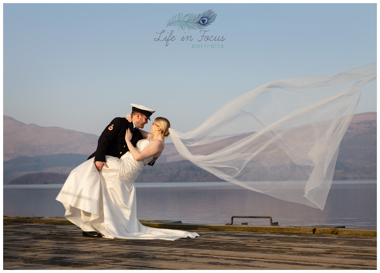 bride and groon wedding photo on Luss pier Loch Lomond Life in Focus Portraits wedding photography Hlensburgh Argyll and Bute