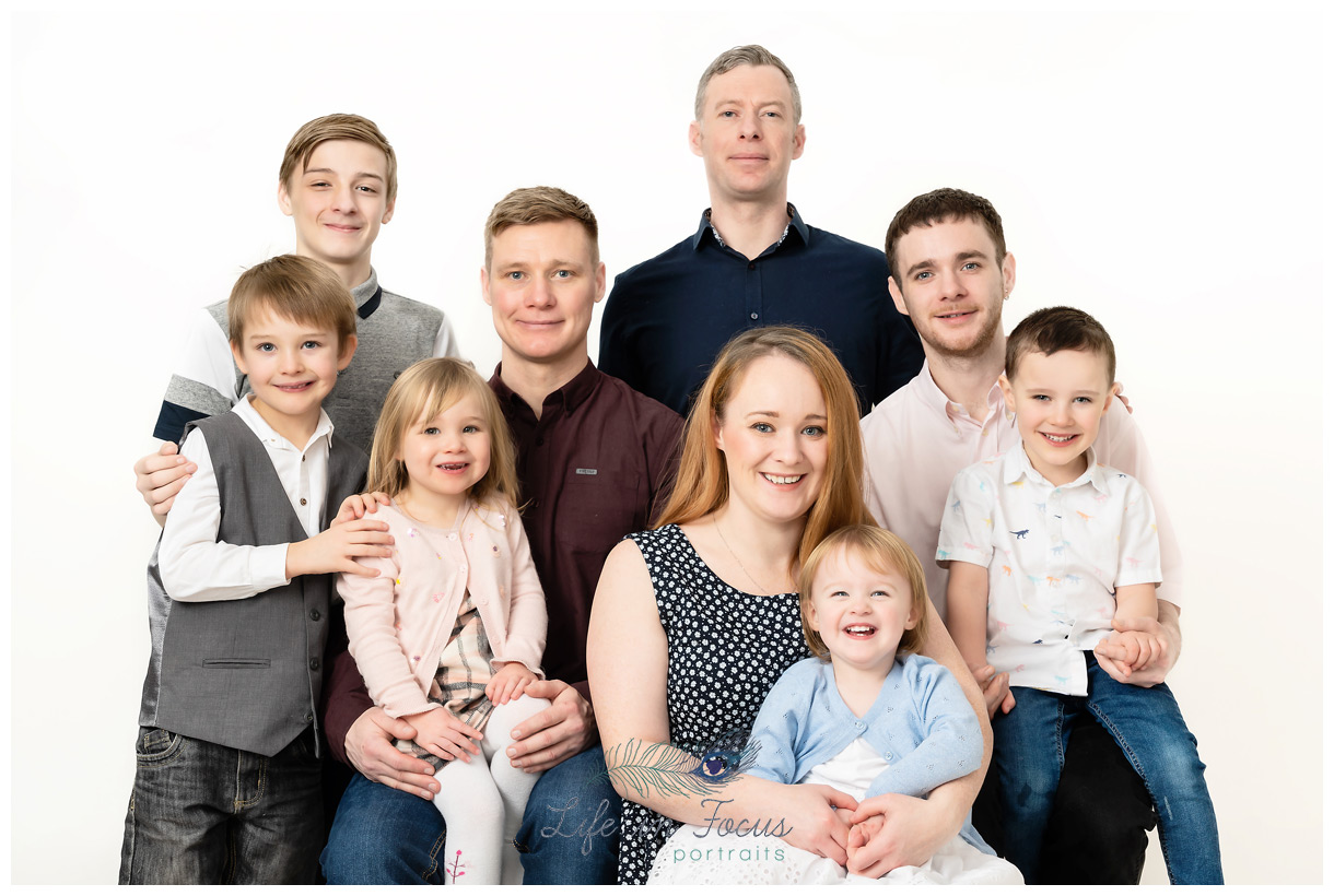 extended family portrait in studio on white background Christmas gift for grandparents Life in Focus Portraits family photography Rhu Helensburgh