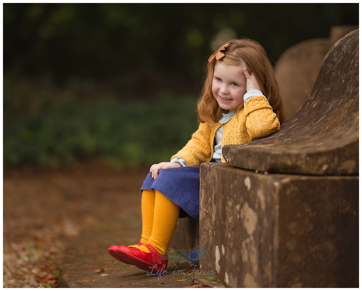 girl in bright clothes laughing Life in Focus Portraits child photographer Rhu Helensburgh