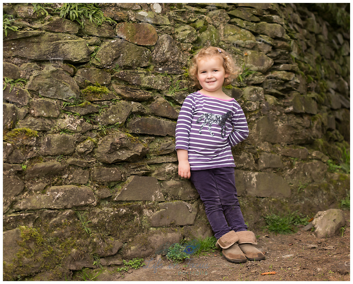 girl leaning against wall on farm holiday cottage Luss Loch Lomond Life in Focus Portraits family vacation photography Loch Lomond Scotland