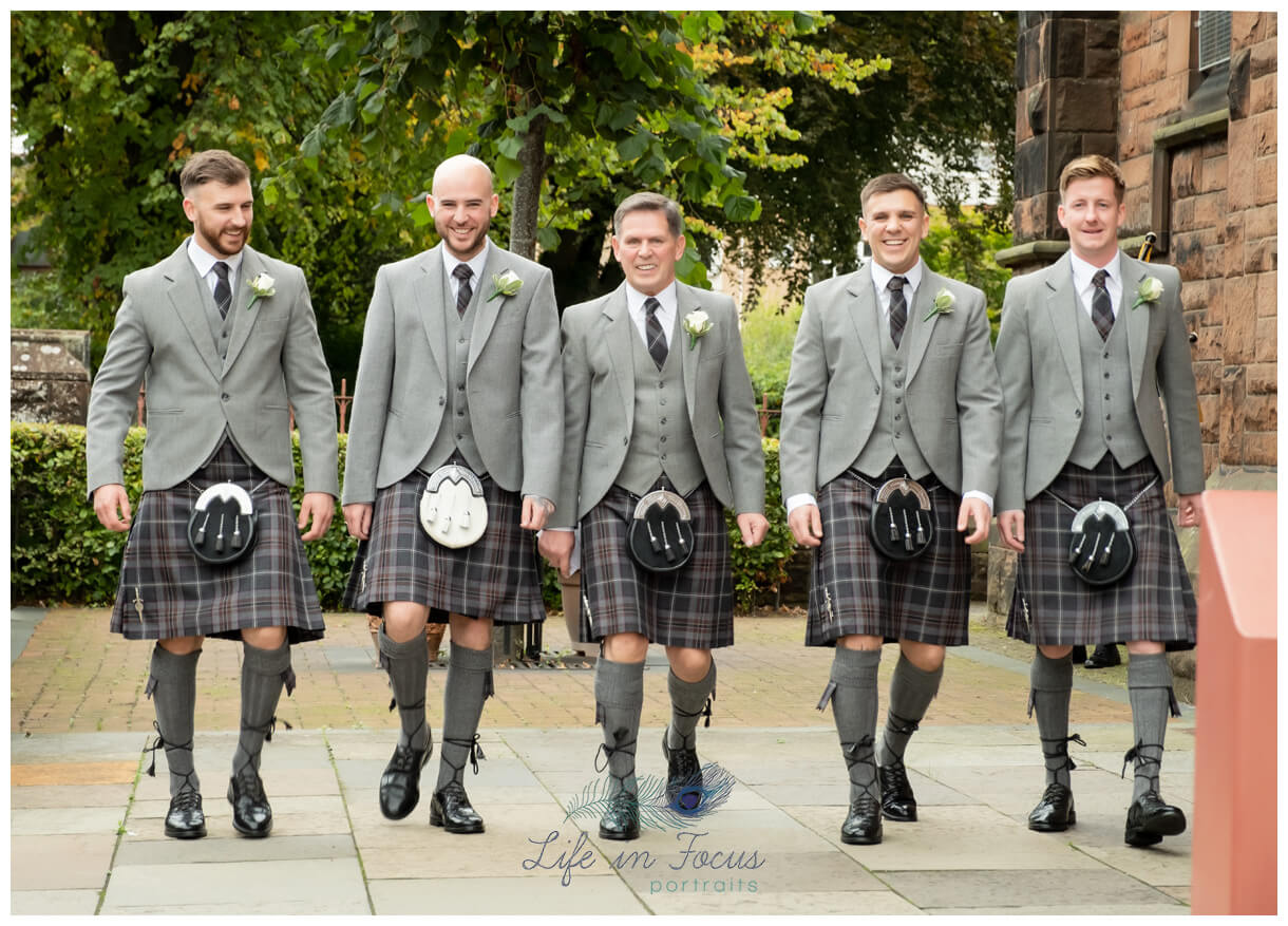 groom and grromsmen in kilts outsideSt PAtricks Church Dumbarton Scottish wedding Life in Focus Portraits wedding photographer