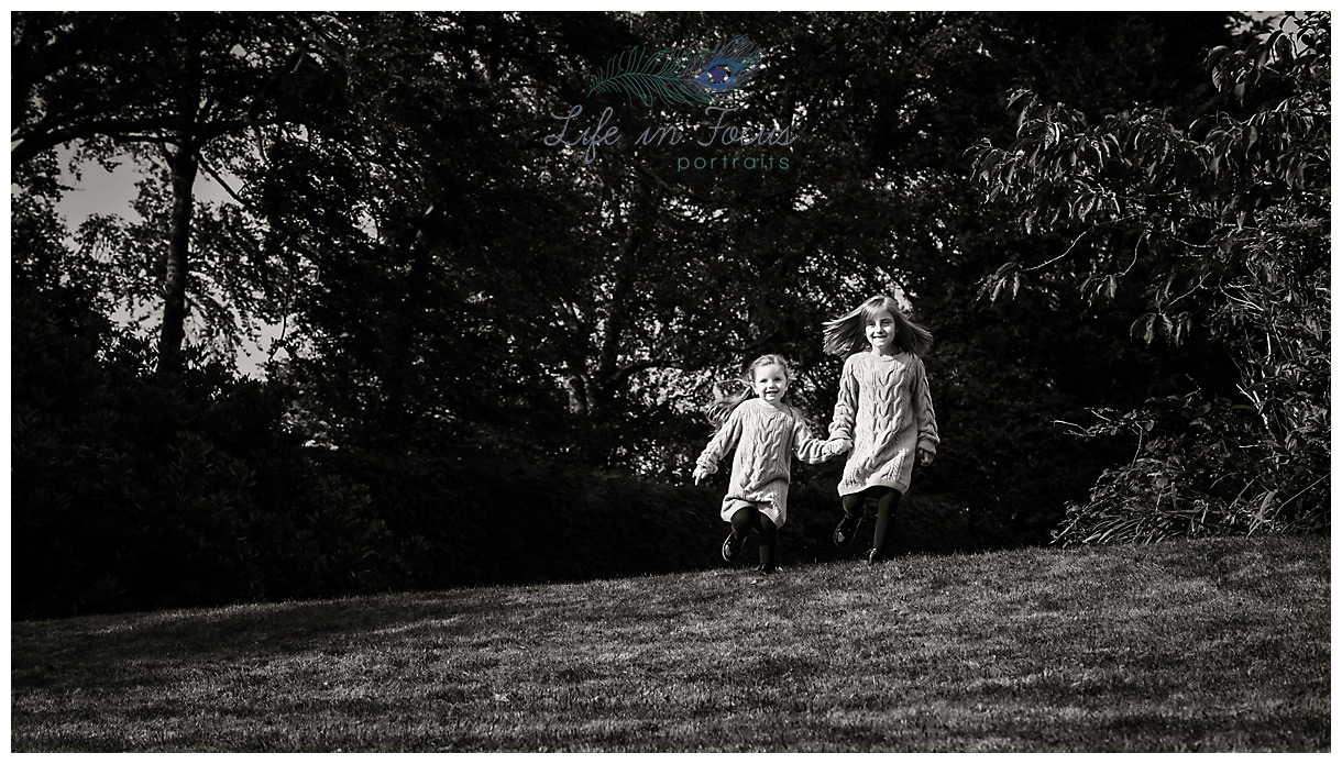 monochrome photo of children running in park outdoor location photoshoot Life in Focus Portraits child photographer Dumbarton