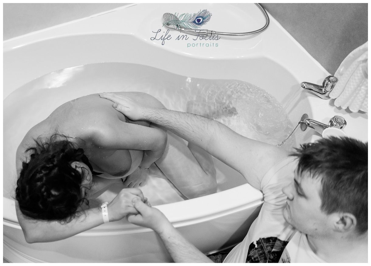 mother labouring in bath birth photography Life in Focus Portraits Welcome to the World Birth photographer RAH Paisley