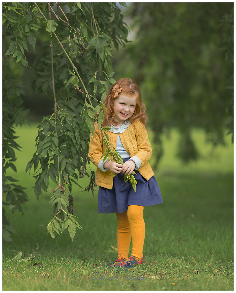 portrait of girl under weeping willow tree outdoor child photography Life in Focus Portraits family photographer Cardross Dunbartonshire
