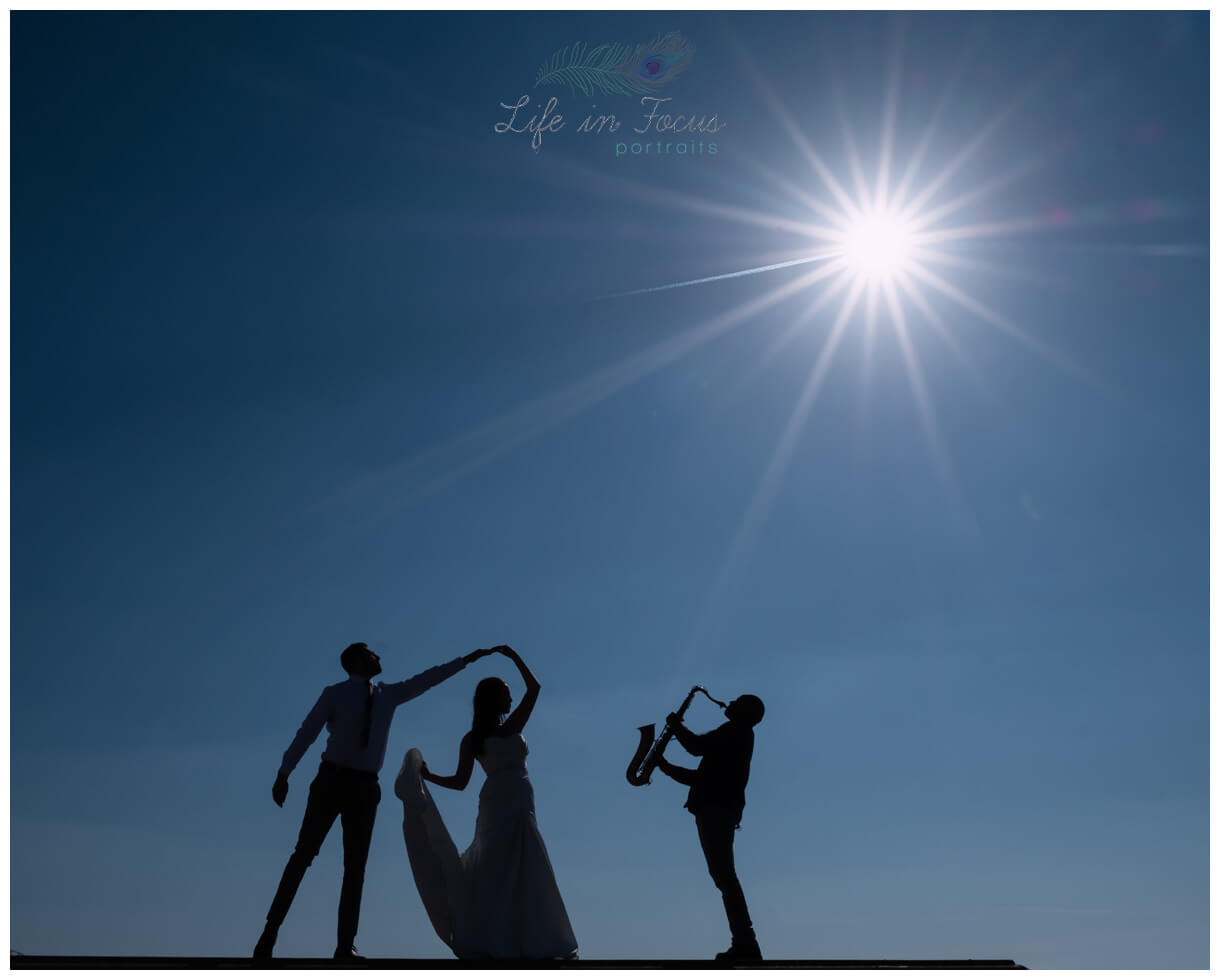 silhouette wedding photo bride and groom dancing saxophone Life in Focus Portraits wedding photographer Helensburgh Loch Lomond