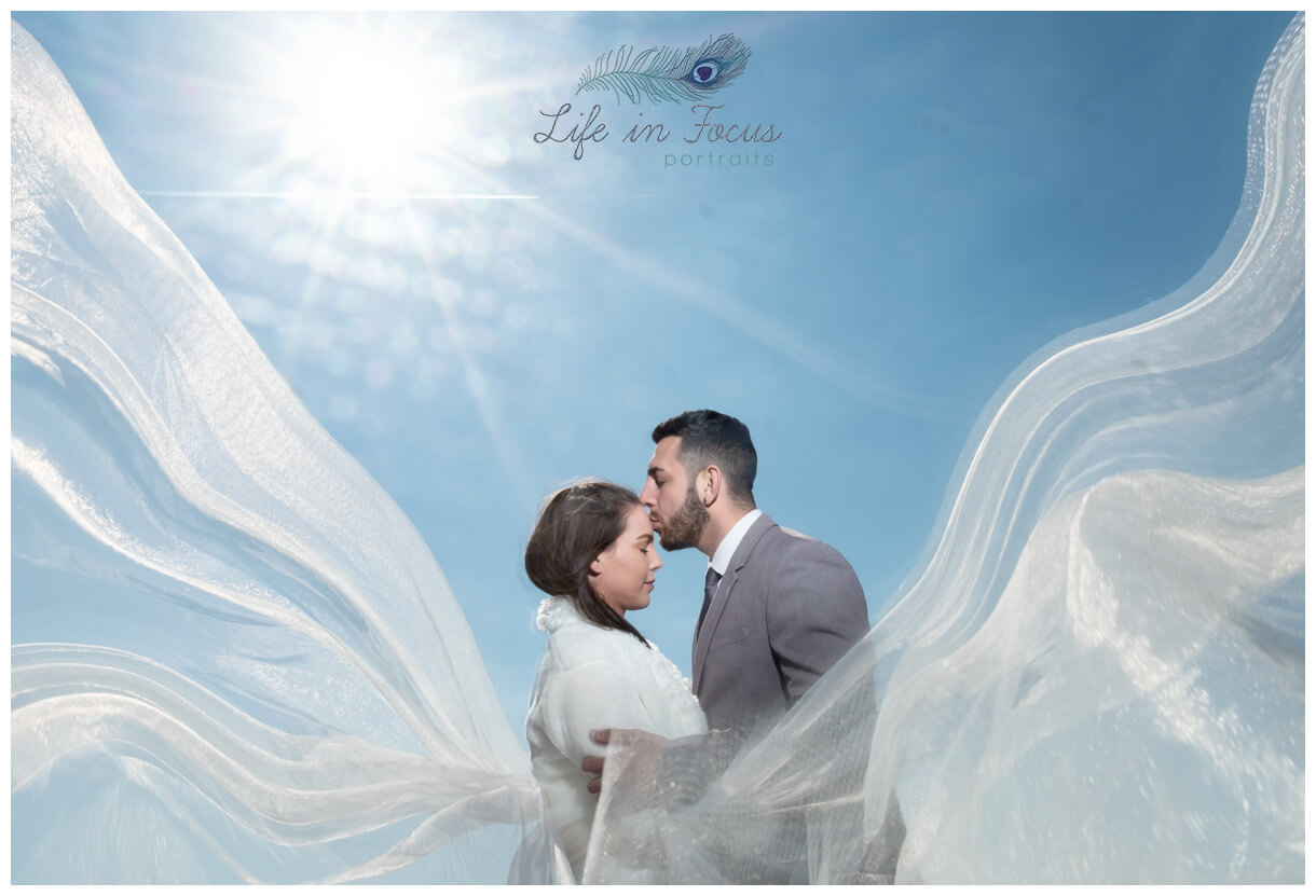 wedding photo bride and groom with veil and sun flare Life in Focus Portraits destination wedding photographer Loch Lomond Argyll and Bute