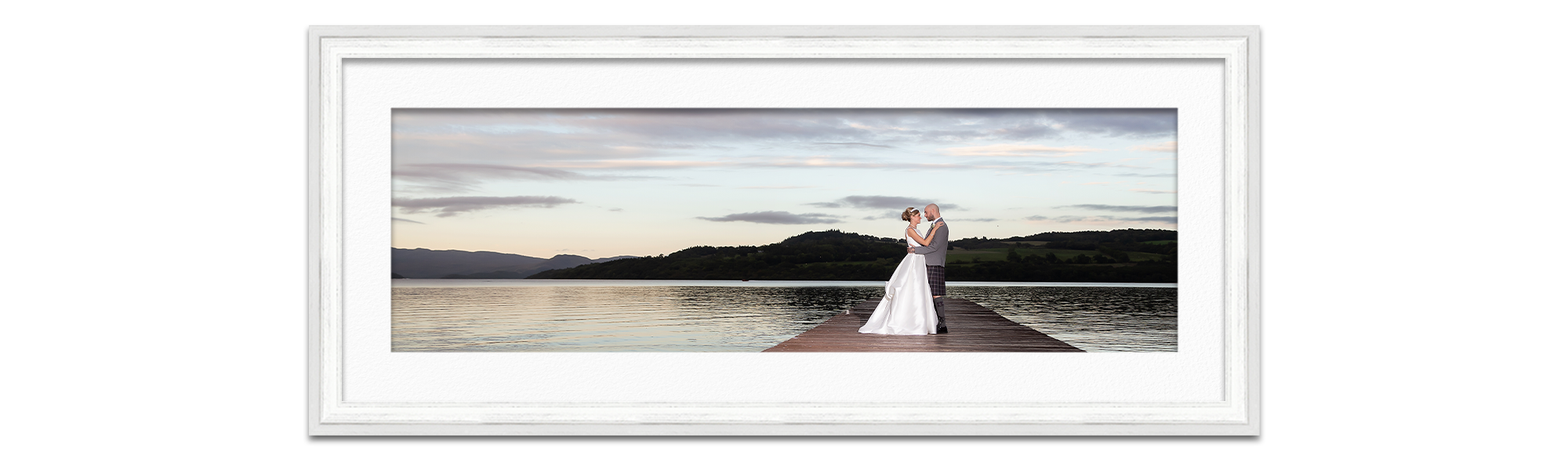 wedding photo newly married husband and wife on pier Duck Bay Hotel Loch Lomond Life in Focus Portraits wedding photographer Helensburgh Luss Argyll and Bute