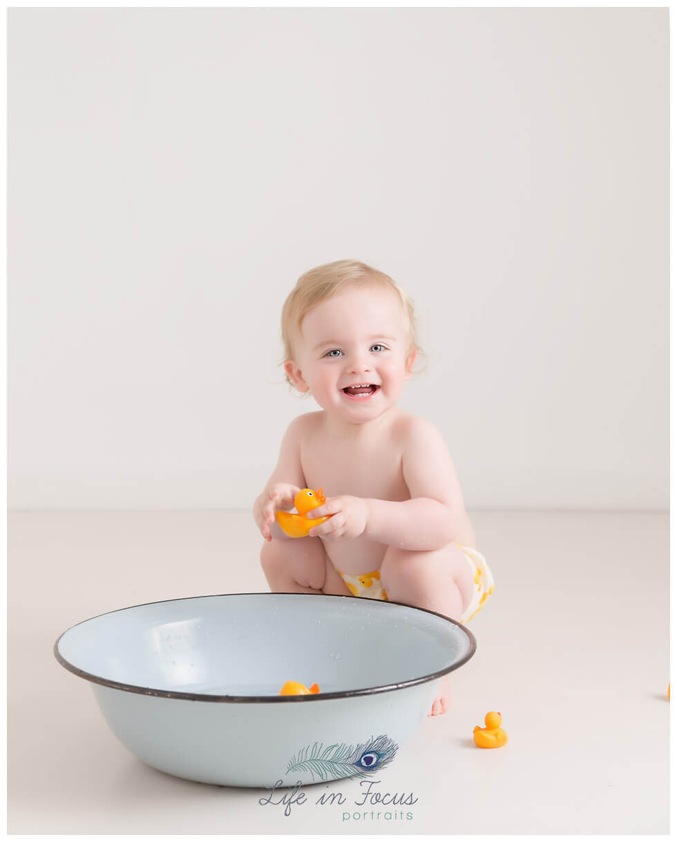 1st birthday photos splashtime Life in Focus Portraits smash & splash photoshoot Rhu Helensburgh