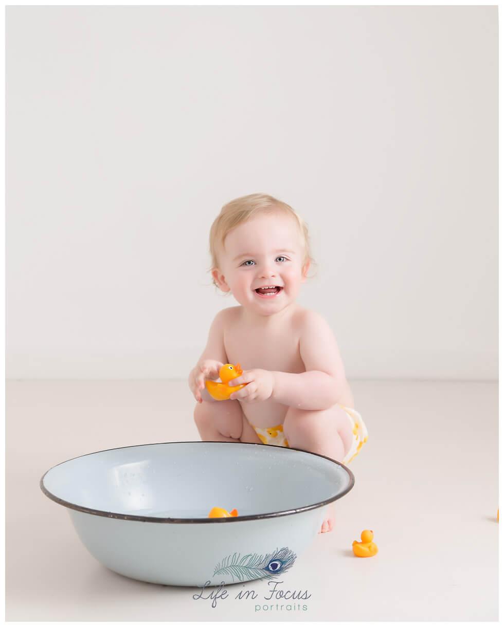 1st birthday photos splashtime Life in Focus Portraits smash & splash photoshoot Rhu Helensburgh
