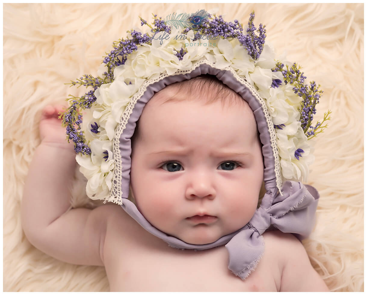 4 month old baby girl in flower bonnet Life in Focus Portraits baby photographer Helensurgh Garelchead Rosneath Peninsula