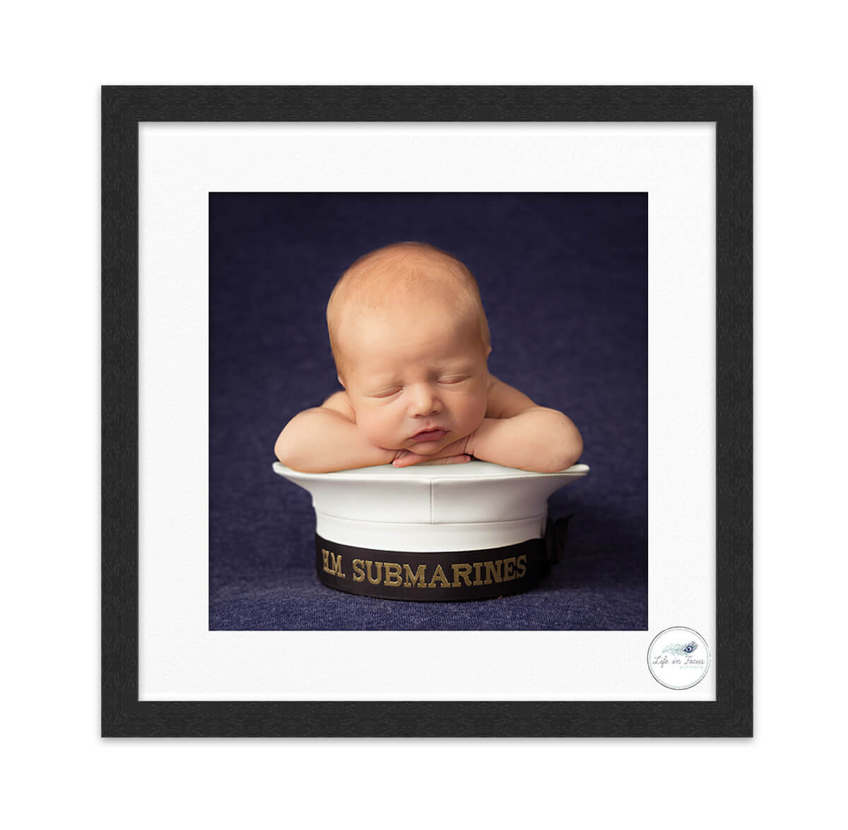 Newborn baby on Royal Navy Submariner cap Life in Focus Portraits baby photographer Faslane HMS Neptune Rhu Helensburgh