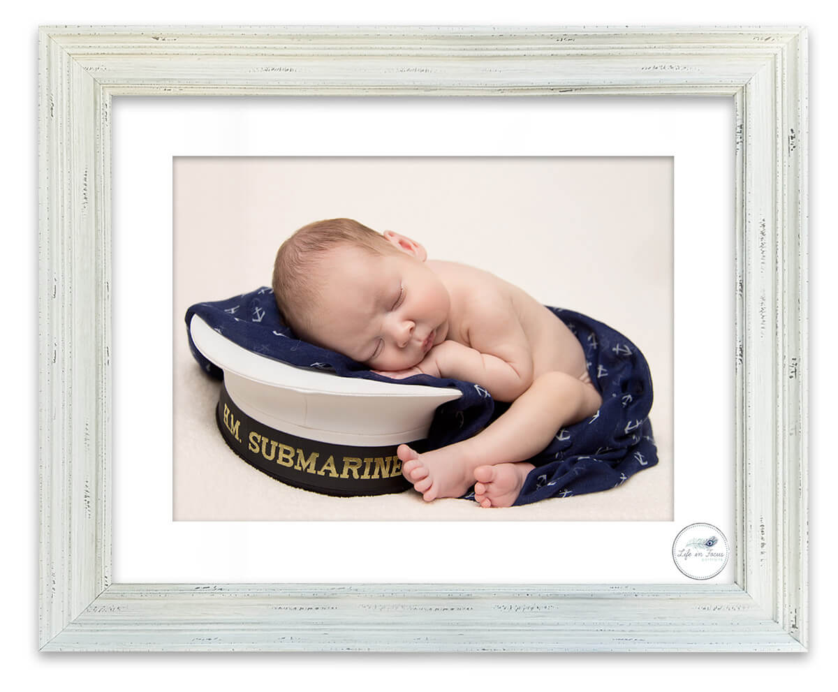 Royal Navy Submariner baby on daddys cap Life in Focus Portraits newborn baby photographer Rhu Helensburgh Garelochhead
