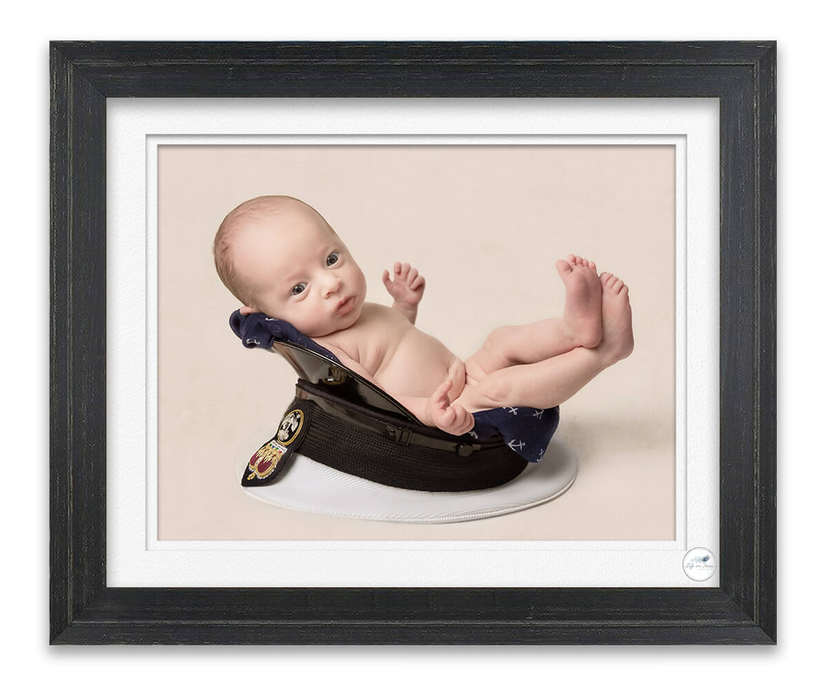 Royal Navy newborn baby in dads submariner cap Life in Focus Portraits newborn baby photo studio Rhu Helensburgh HMNB Clyde