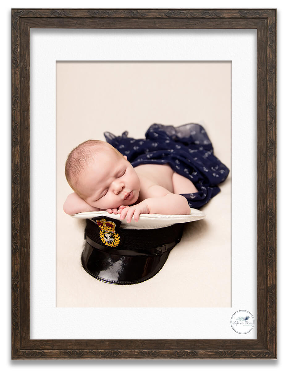 Royal Navy newborn baby on daddys cap Life in Focus Portraits newborn baby photography studio Rhu Helensburgh Argyll and Bute