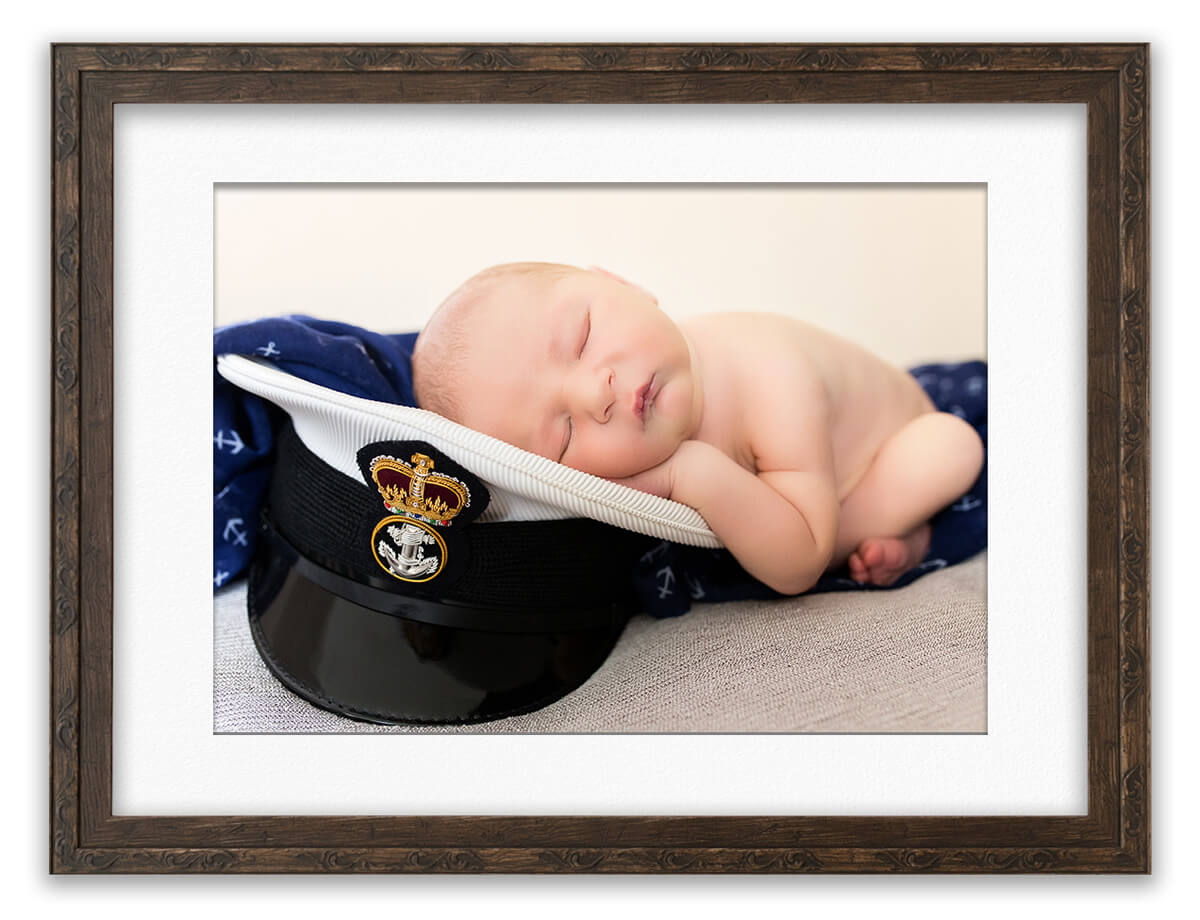 Royal navy baby on Daddy's submariner cap Life in Focus Portraits Helensburgh photography studio Faslane Garelochhead Rhu