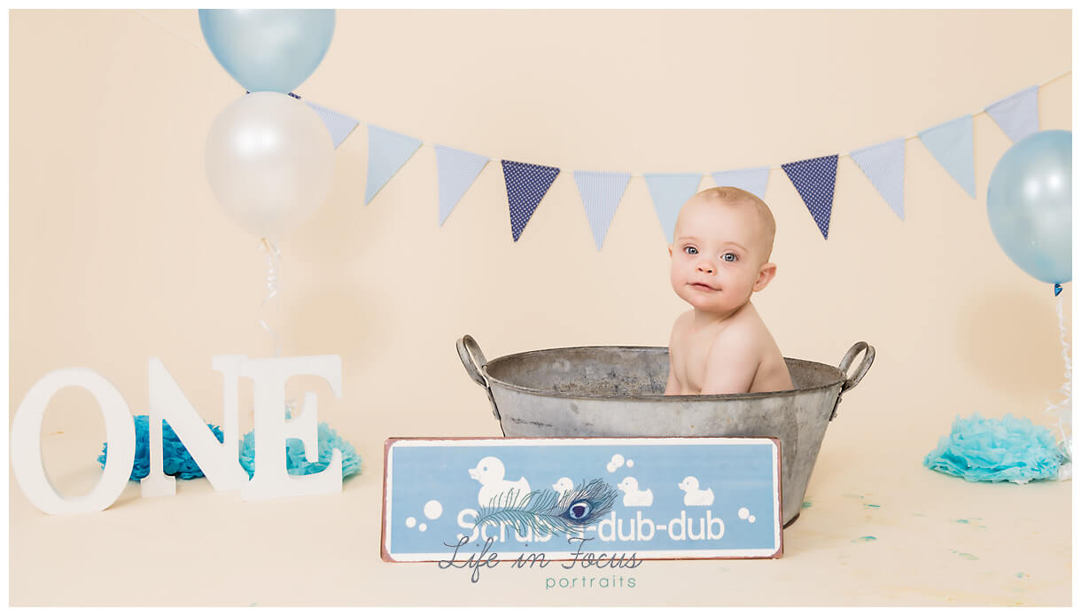 Splash time 1st birthday photoshoot bath time after cake smash Life in Focus Portraits baby photographer Rhu Helensburgh Cardross