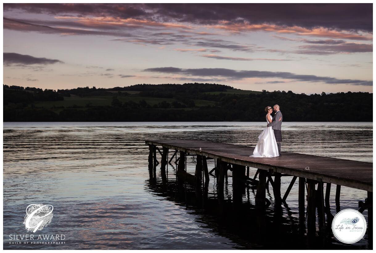 Wedding photo couple at Duck Bay Hotel award winning photo Life in Focus Portraits award winning wedding photographer Loch Lomond