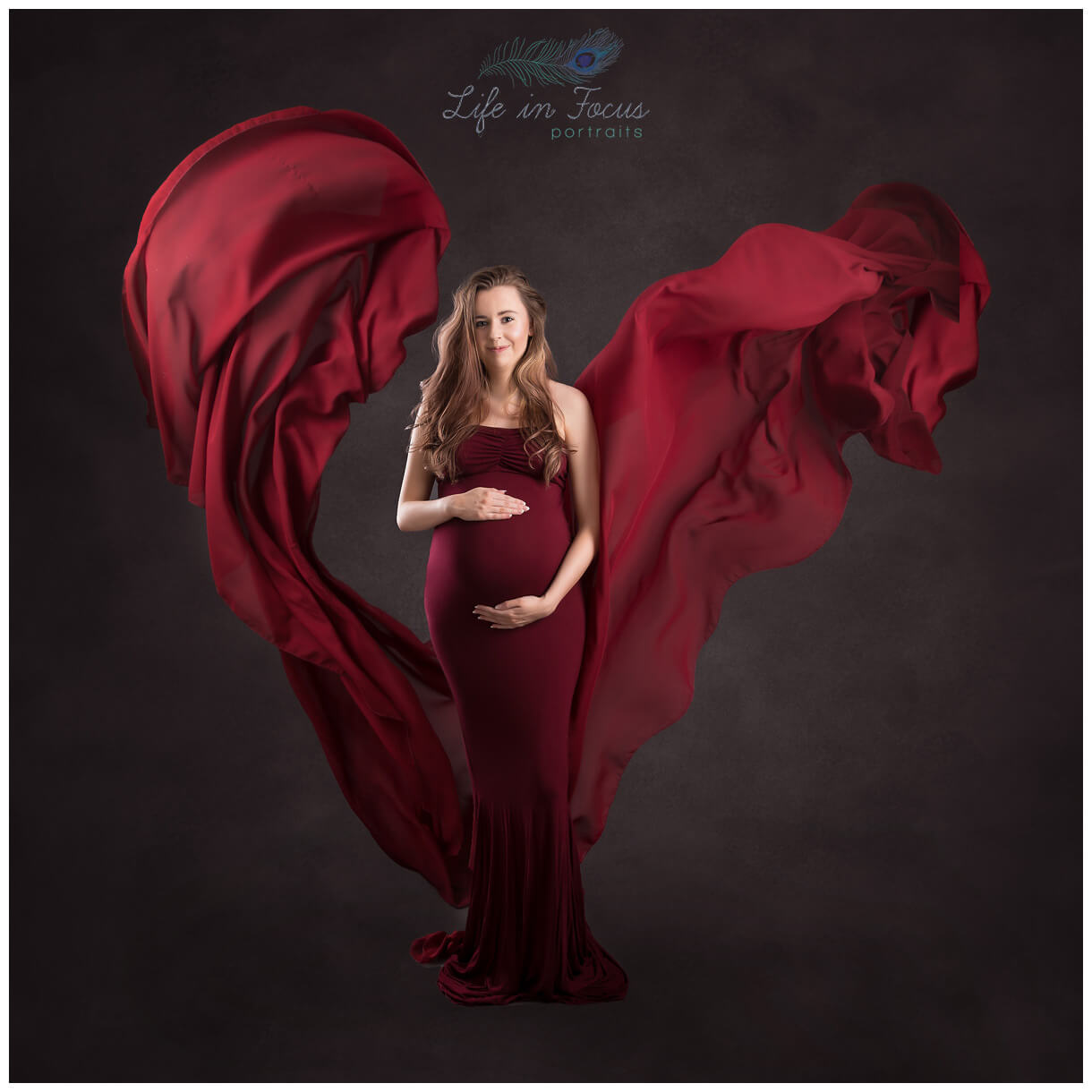 artistic pregnancy photography with flowing red dress Life in Focus Portraits maternity photoshoot Rhu Helensburgh Cove