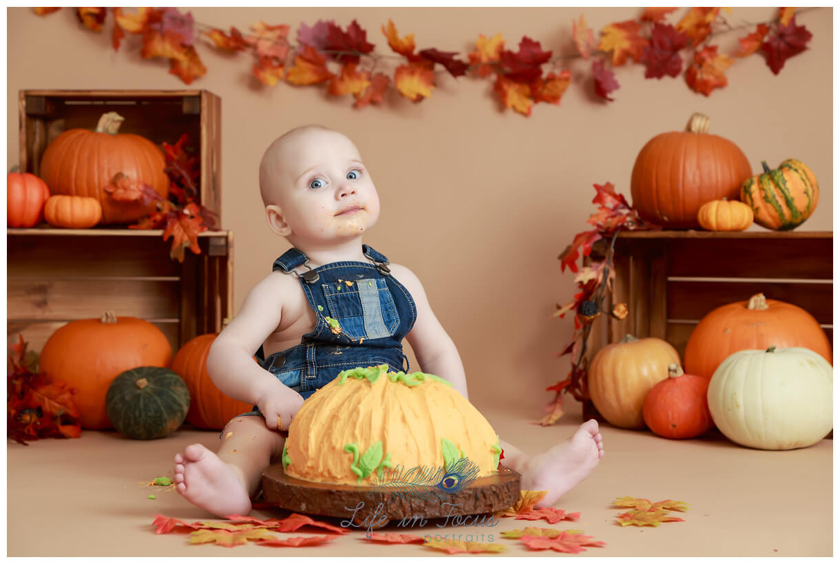 autumn pumpkin themed cake smash Life in Focus Portraits 1st birthday cake smash photography Rhu Helensburgh