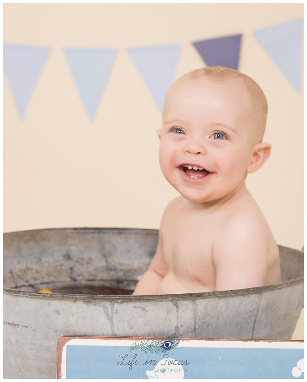 baby boy smiling in vintage bathtub Life in Focus Portraits baby photographer Arrochar Tarbet Luss
