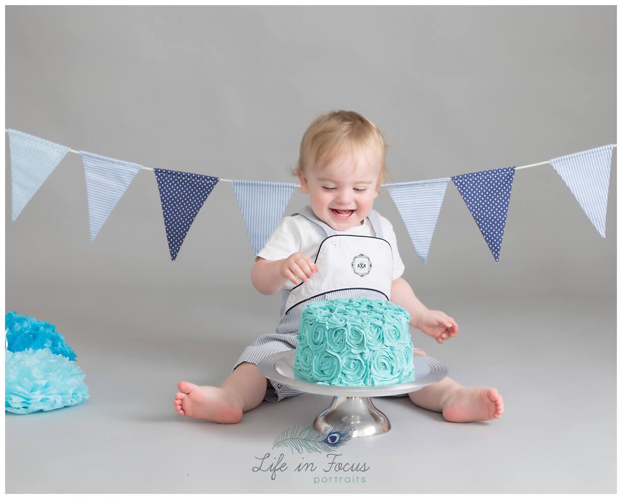 baby boy with 1st birthday cake Life in Focus Portraits Cake Smash photography Luss Balloch Aleaxandria