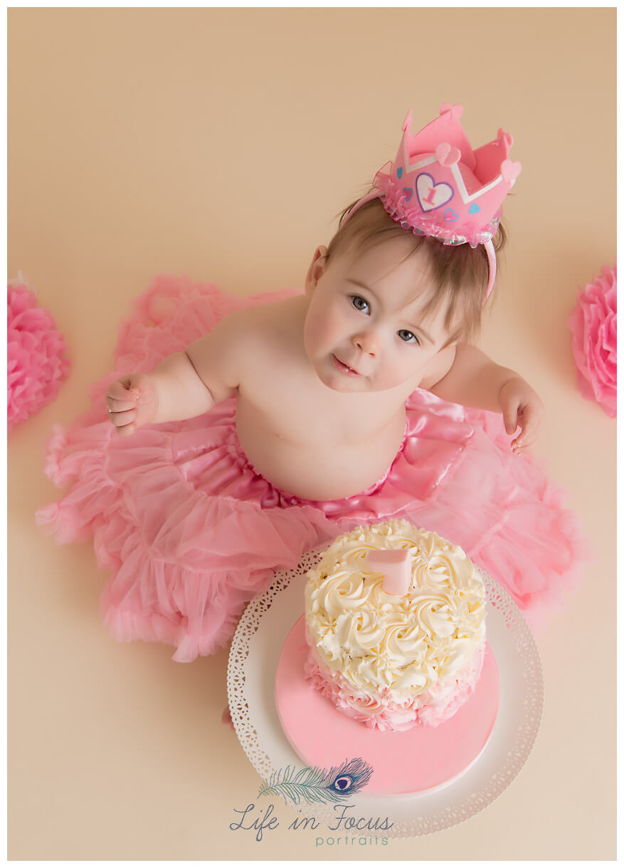 baby girl cake smash photos Life in Focus Portraits smash and splash sessions Rhu Garelochhead Rosneath Cove
