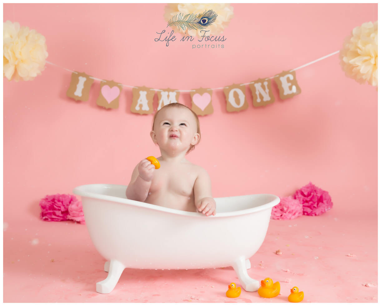 baby girl in bathtub pink themed cake smash photoshoot Life in Focus Portraits baby photographer Arrochar Tarbet Luss
