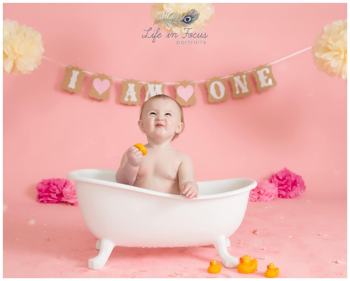 baby girl in bathtub pink themed cake smash photoshoot Life in Focus Portraits baby photographer Arrochar Tarbet Luss