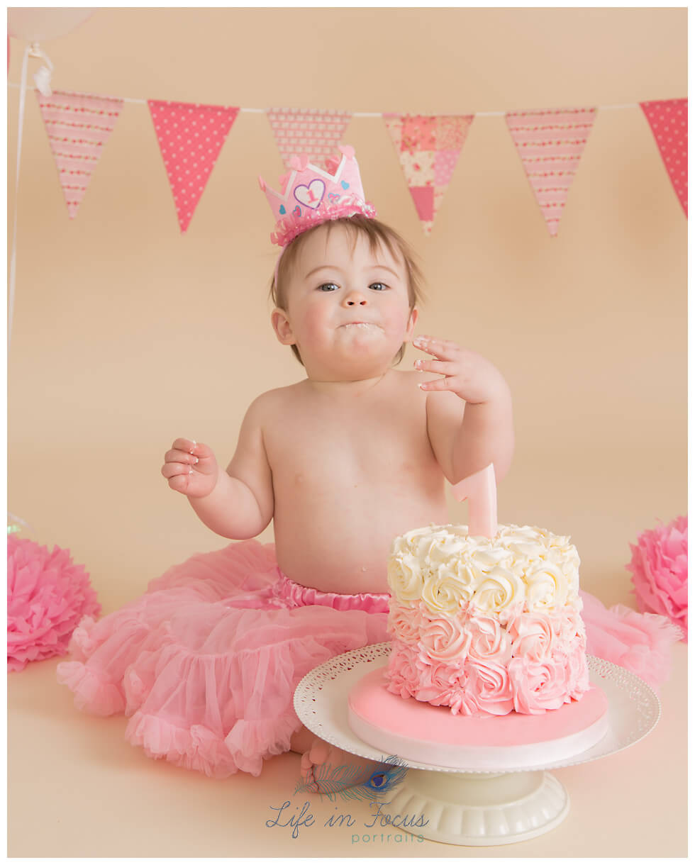 baby girl in tutu cake smash photo Life in Focus Portraits first birthday photo sessions Rhu Helensburgh Balloch