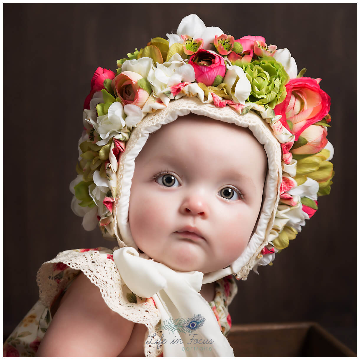 baby in flower bonnet little sitter session Life in Focus Portraits baby milestone photography Rhu Helensburgh Cardross