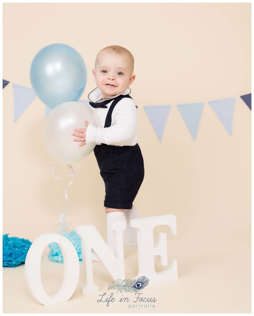 baby with balloons 1st Birthday photos Life in Focus Portraits first birthday photography sessions Rhu Helensburgh