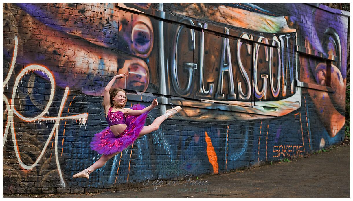 ballerina leaping Glasgow graffiti urban dance photography Life in Focus Portraits dance photographer Rhu Helensburgh