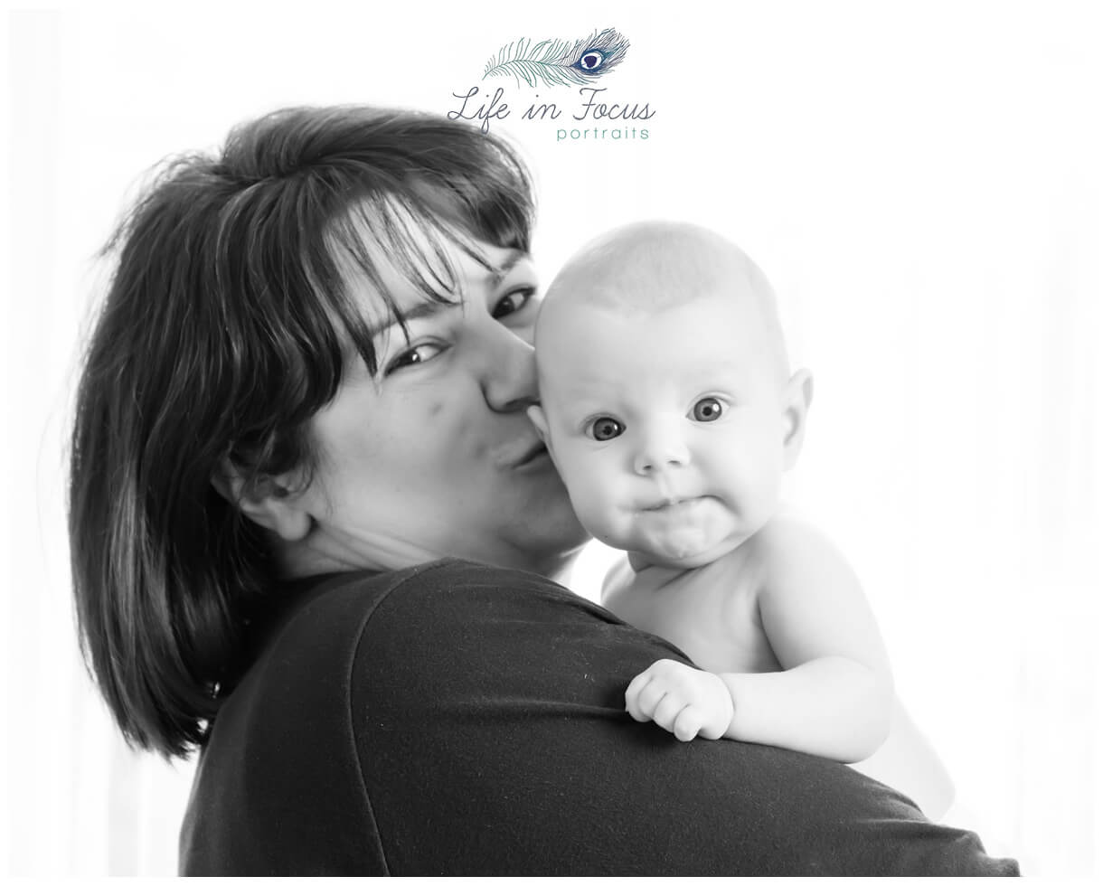 black and white photo mum kissing baby daughter Life in Focus Portraits baby photoshoots Helensburgh Cardross Dumbarton