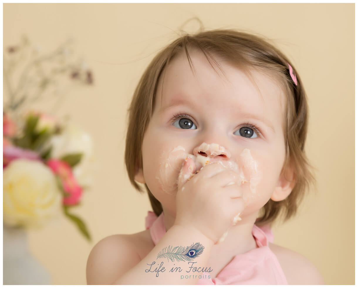 cake smash photo Life in Focus Portraits Smash and Splash 1st birthday photoshoot Rhu Helensburgh