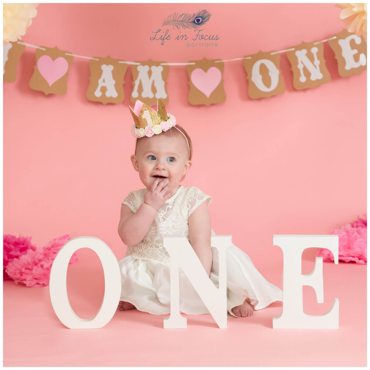 cute photo of baby gorl 1st Birthday photo shoot Rhu Life in Focus Portriats baby photography studio Helensburgh