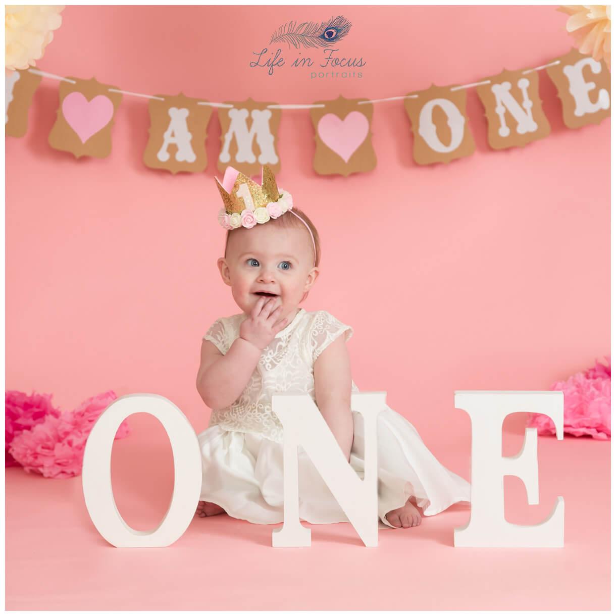 cute photo of baby gorl 1st Birthday photo shoot Rhu Life in Focus Portriats baby photography studio Helensburgh