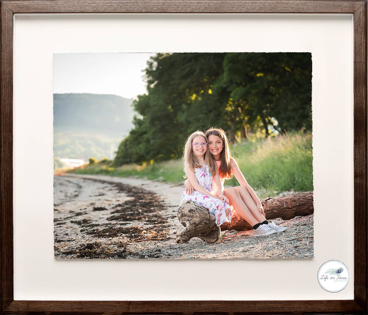 framed outdoor photo sisters on beach by loch Life in Focus Portraits child & family photographer Helensburgh & Loch Lomond