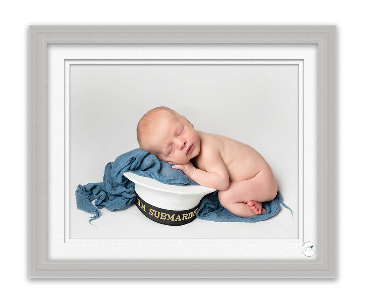 newborn baby boy on royal navy Cap Life in Focus Portraits newborn baby photo studio Faslane Naval Base Rhu Helensburgh