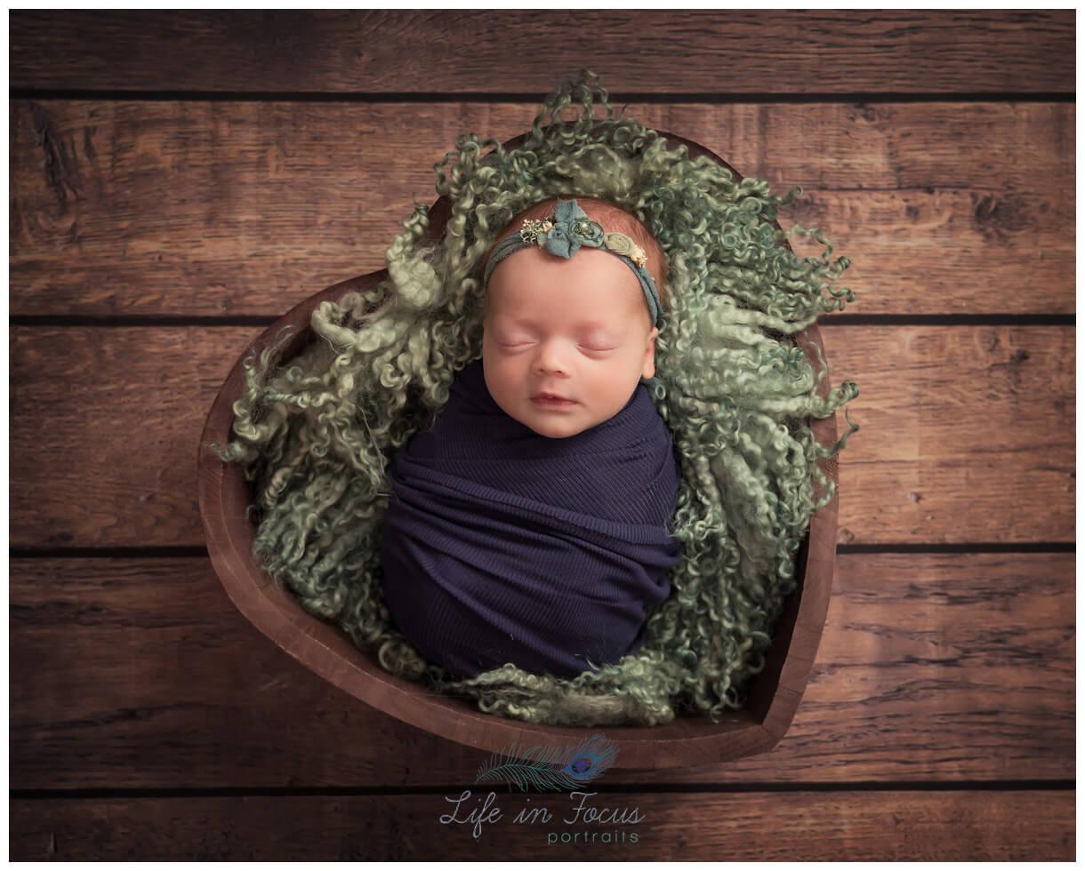 photo of newborn baby girl in heart Life in Focus Portraits newborn photography studio Rhu Helensburgh
