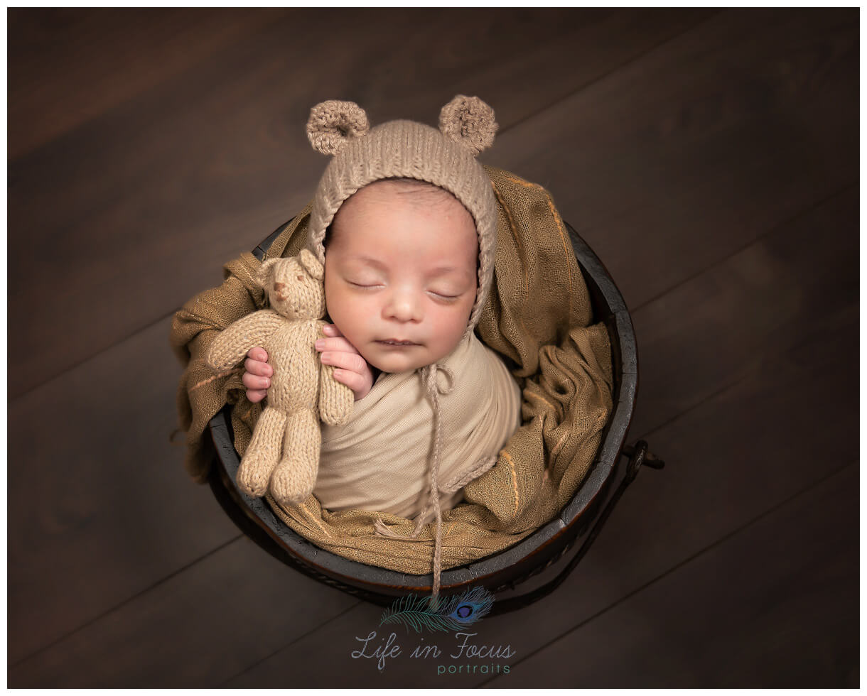 photograph of newborn baby boy holding teddy Life in Focus Portraits newbonr baby photographer Rhu Helensburgh Cardross Dumbarton