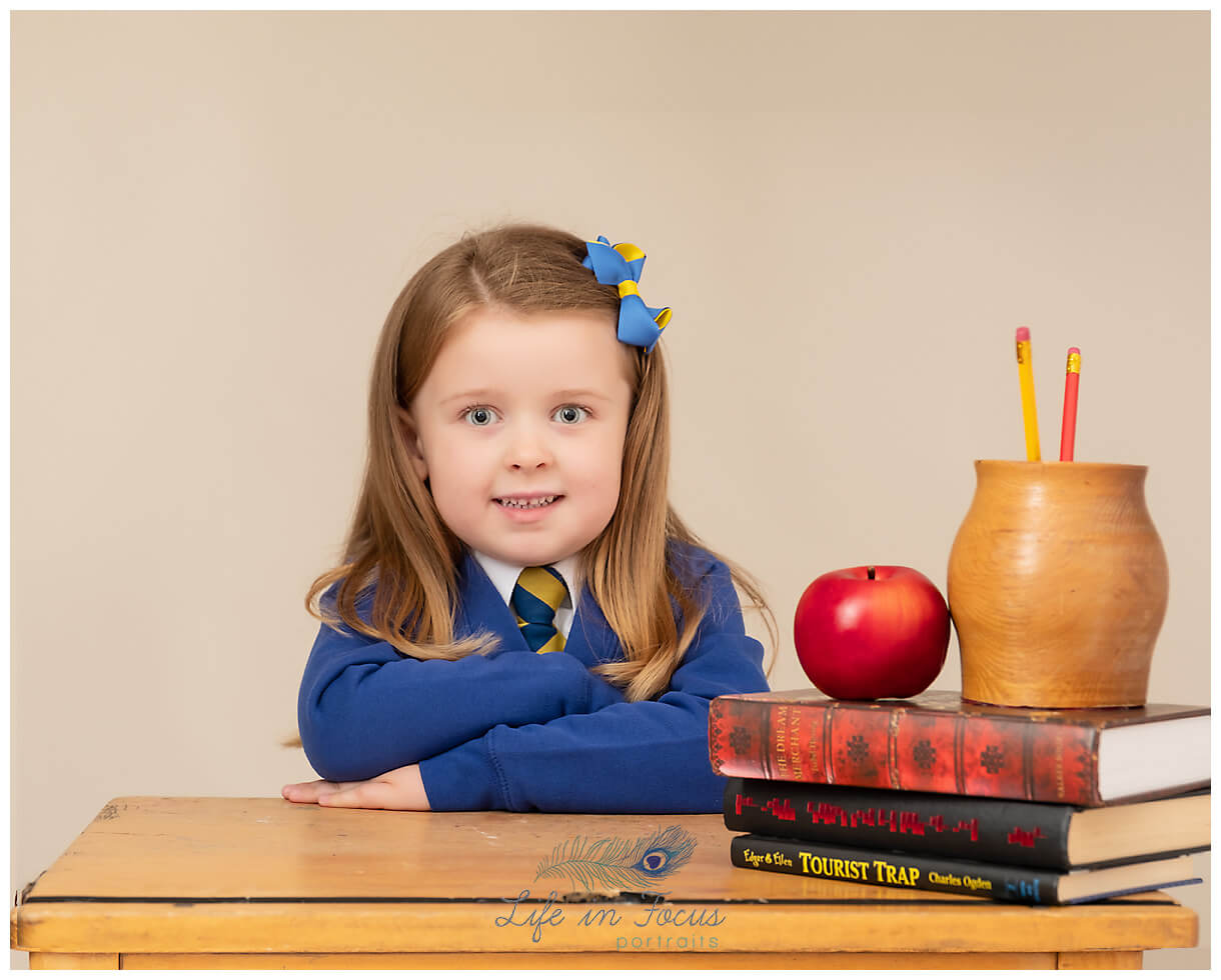 Primary 1 child school desk with books Life in Focus Portraits school and nursery photography JLB school Helensburgh