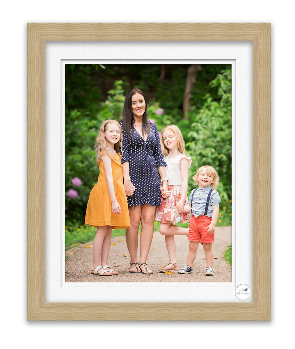 photo of family standing together in park Life in Focus Portraits Helensburgh outdoor photographer