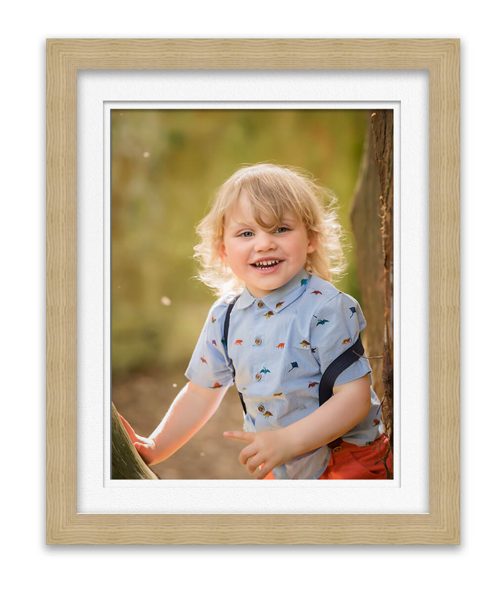 photo of little boy smiling at photographer Life in Focus Portraits family outdoor photoshootss Helensburgh