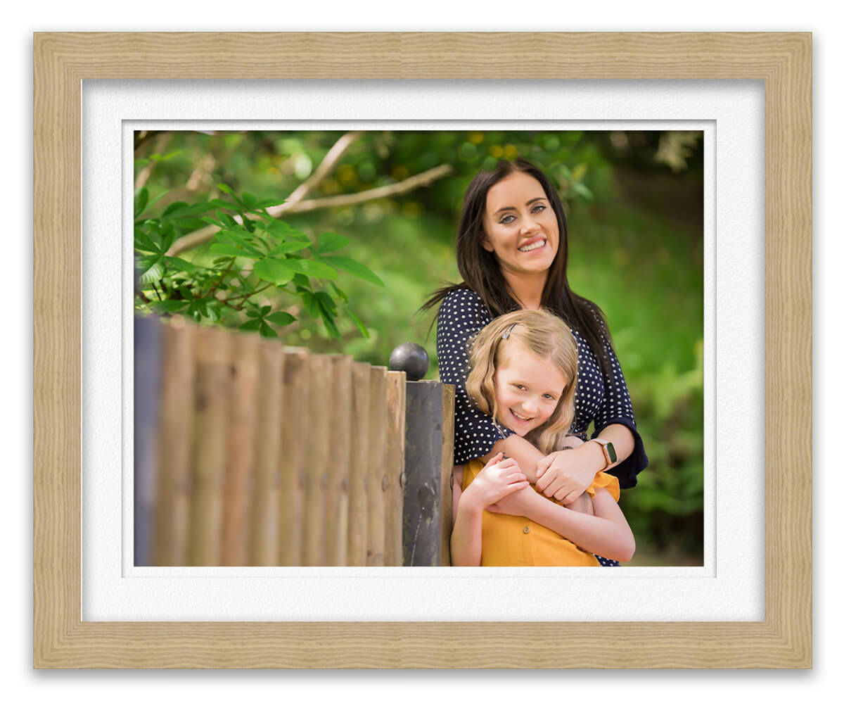 photo of mum and daughter in park smiling at photographer Life in Focus Portraits family photographer Rhu Helensburgh Dumbarton