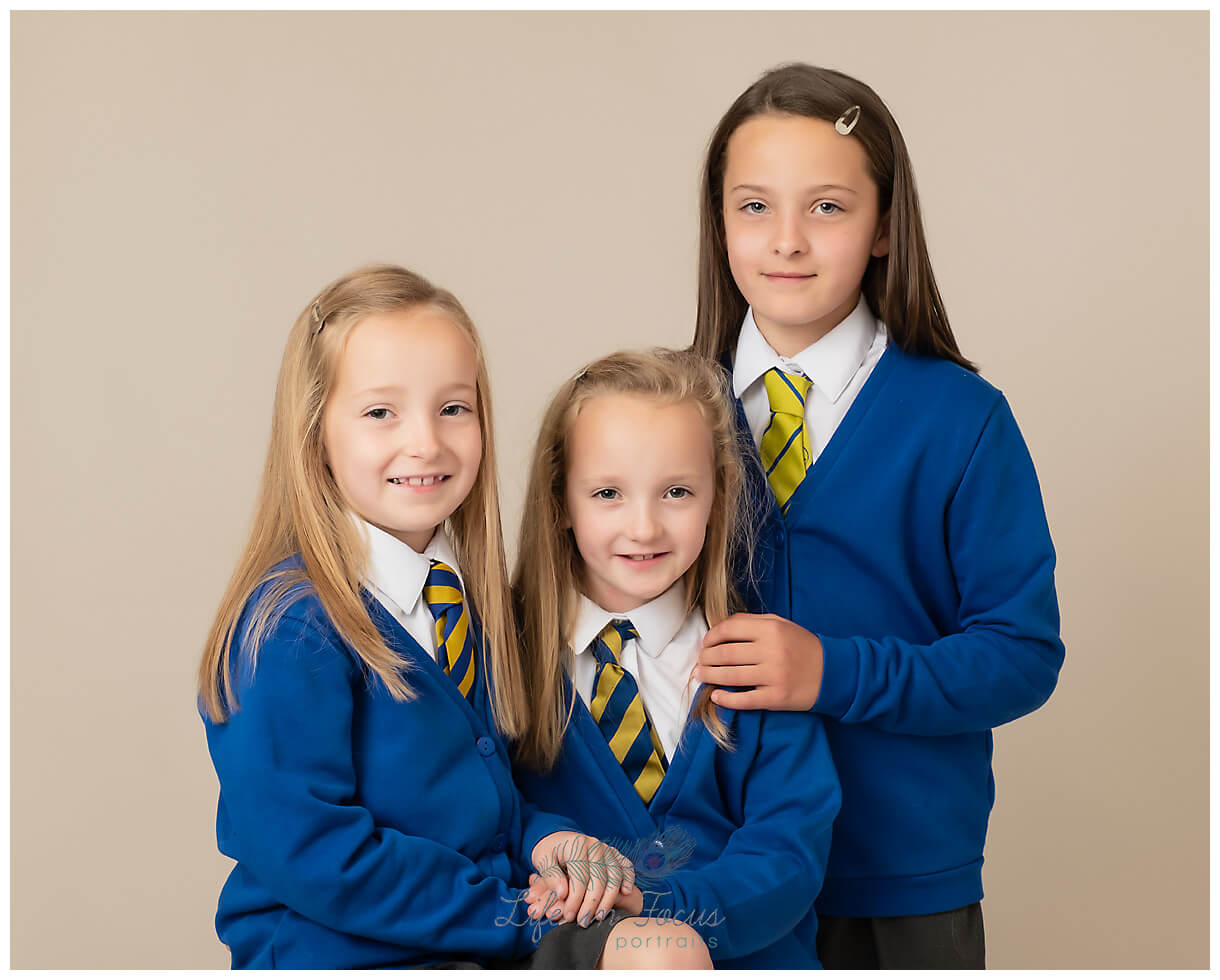 sisters sibling school photo Life in Focus Portraits school and nursery photography Rhu John Logie Baird Primary School Helensburgh